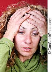 Woman with headache - Digital photo of a woman.