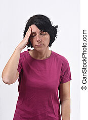 woman with headache on white background