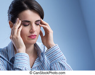 Woman with headache - Young woman with headache touching her...
