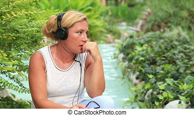 Woman with headphone listen to music outdoor