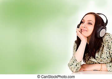Woman with headphones in front of a green background