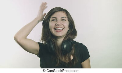 Woman with headphones laughing