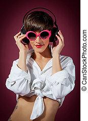 Woman with headphones listening music - Retro style