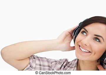 Woman with headphones looking up
