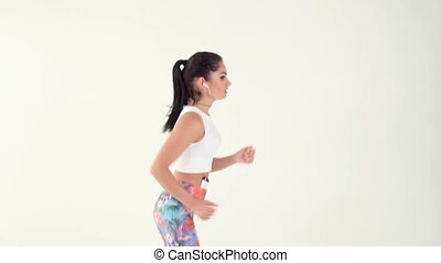 woman with headphones running
