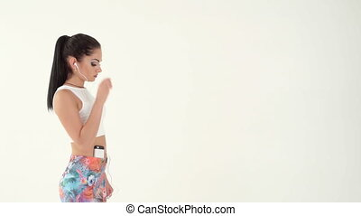 woman with headphones running - sporty brunette woman with...