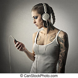 Woman with headphones - Woman with tattoos with headphones