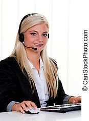 woman with headset and computer hotline at