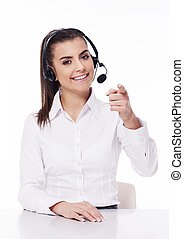 Woman with headset pointing at you