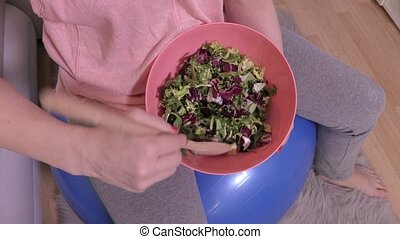 Woman with healthy food after workout