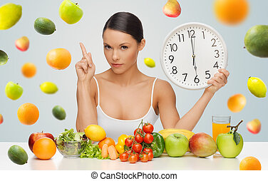 woman with healthy food and clock warning