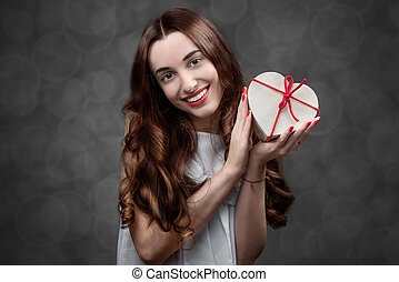 Woman with heart box