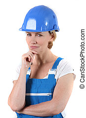 Woman with helmet and hand on chin
