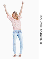 Woman with her arms raised is cheering