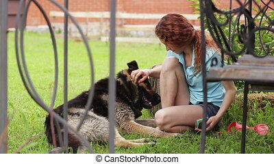 Woman with her beautiful dog resting outdoors