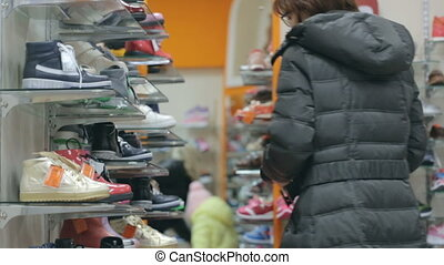 Woman with her daughter at shoe store