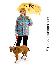 Woman with her dog in the rain