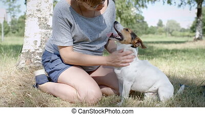Woman with her dog on the grass