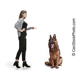 Woman with her dog over white background