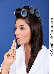 Woman with her hair in large Velcro rollers