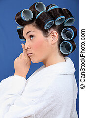 Woman with her hair in rollers