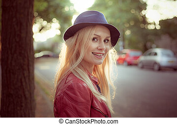 Woman with her long blond hair backlit by the sun