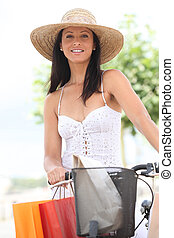 Woman with her shopping bags and her bike