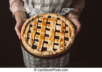 woman with homemade pie