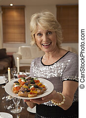 Woman With Hors D'oeuvres For A Dinner Party