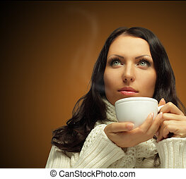 Woman with hot coffee on dark brown background