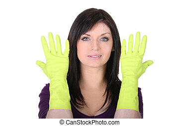 Woman with household gloves on white background