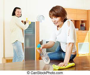 woman with husband cleaning  at home