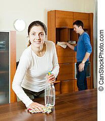woman with husband cleaning room