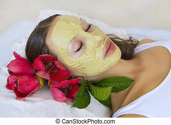 Woman with Indian Multani Matti clay facial mask, beauty spa...