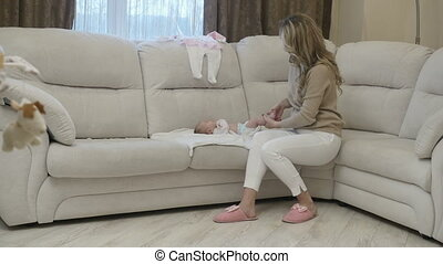 Woman with infant child on sofa