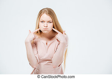 Woman with inflated cheeks