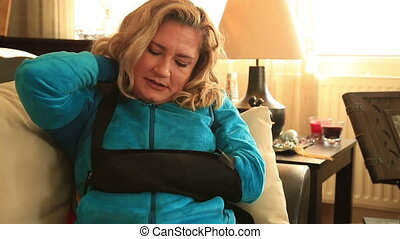 Woman with injured arm and bandage