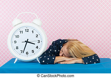 Woman with insomnia and big alarm clock