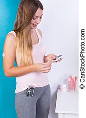 Woman with insulin pump device