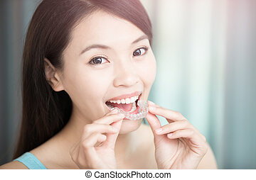 woman with invisible braces