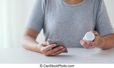 woman with jar of medicine pills and tablet pc - medicine,...