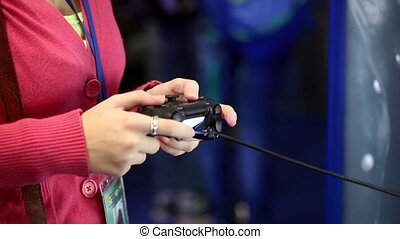 Woman with joystick playing video games