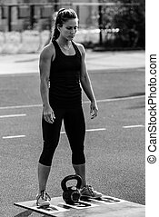 Woman with kettle bell on competition