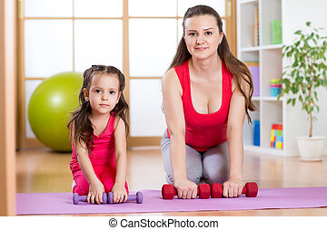Woman with kid doing gym and fitness exercises