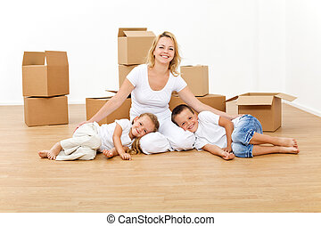 Woman with kids in their new big home