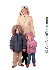 Woman with kids in winter dresses