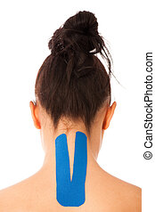 Woman with Kinesiotape on her neck to isolate movement after injury