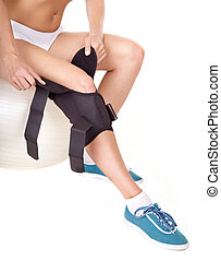Woman with knee brace.