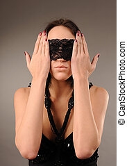 woman with lace fastened on her eyes