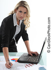 Woman with laptop and graphs